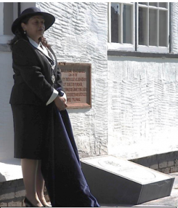 Councillor Razia Daniels, Deputy Lord Mayor of Chester, unveiling the commemorative stone to Billy Congreve. This has been set directly below the foundation stone which was laid on 28 July 1906 as a memorial to Henry Neville Gladstone who donated the Hall – then the Village Institute – to Burton village.