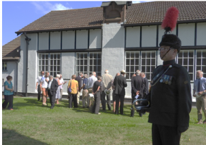 Bugle Major Mark Douglas and some of visitors and local residents attending the unveiling.