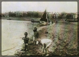 Parkgate shore, children playing, circa 1910.