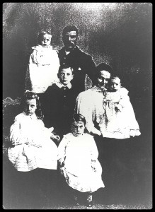 The Bushell family expands. Clock wise from top left: Father Thomas with baby Jim , Reggie, Clara with baby Mollie, Eva, Lizzie. circa 1910